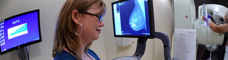 technician performing a mammogram