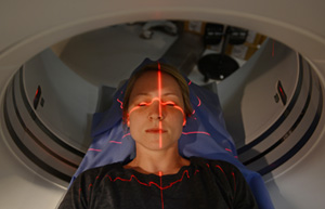 technologist with a patient having a CT Scan