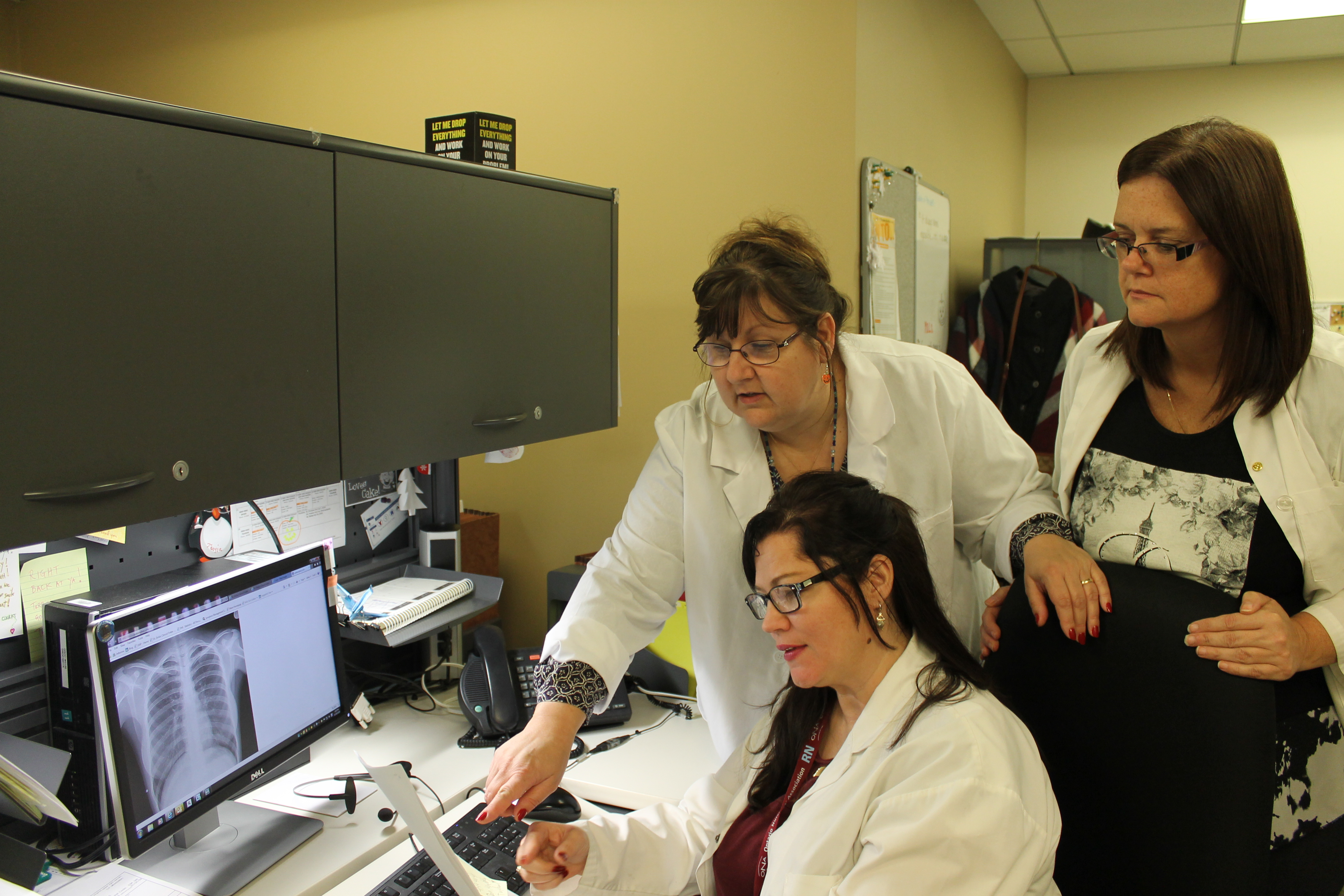 nurses working at a computer