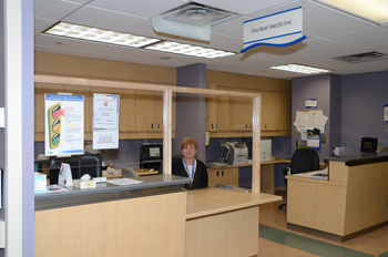 clerk at nuclear medicine reception desk