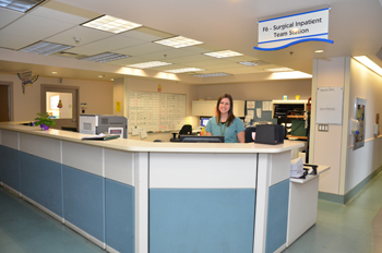 a nurse standing at a nursing station