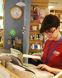Student volunteer in Oshawa gift shop.