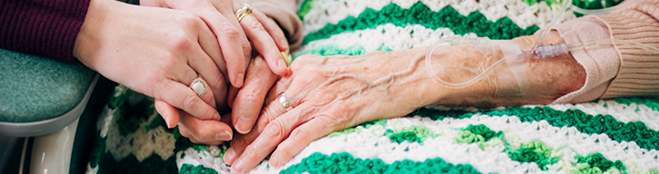family members holding hands