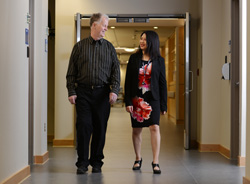 male patient and doctor walking in the hallway