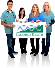 Staff holding Lakeridge Health sign